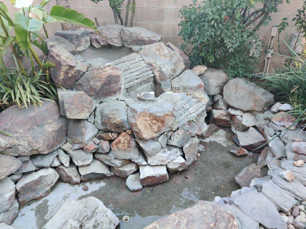 Stone pond sandblasted to look like new.