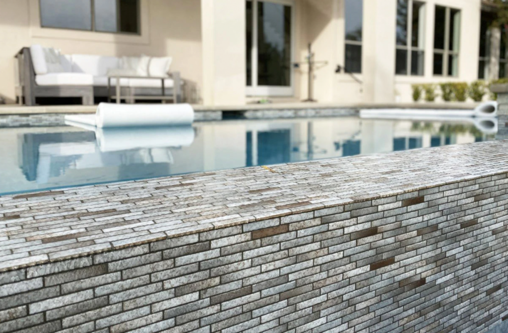Up close look at an infinity pool that was sandblasted.